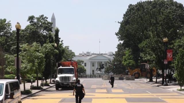 police officers secure the are after they removed protesters from lafayette park for cleaning in washington dc on june 23 2020 us president trump on... - lafayette square washington dc stock videos & royalty-free footage