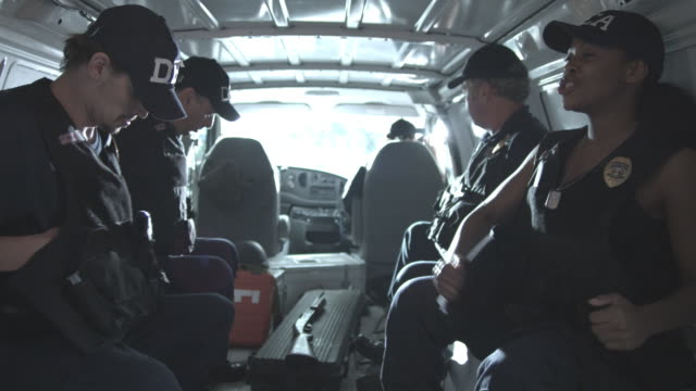MS, Police officers sitting in police van, Staten Island, New York City, New York State, USA