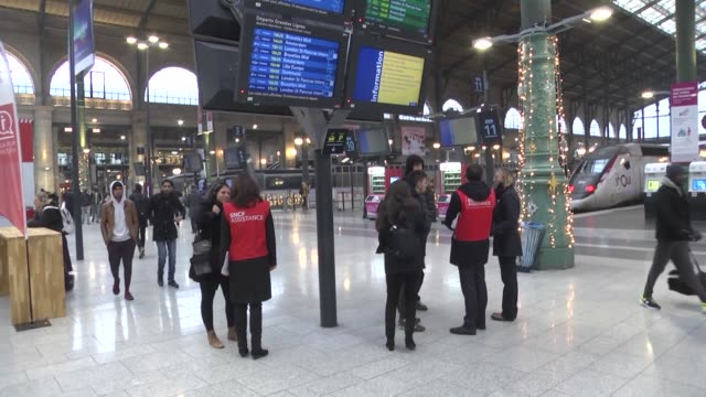 vidéos et rushes de police officers take security measures outside the gare du nord metro station during a strike of paris public transports operator ratp and public... - grève