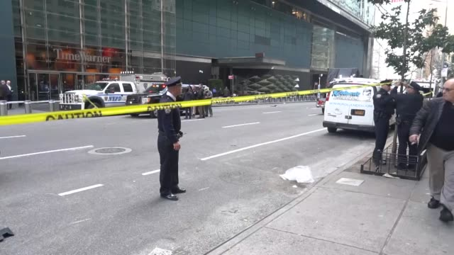 police officers take security measures outside the time warner building where a suspected explosive device was found in the building after it was... - cnn stock videos & royalty-free footage