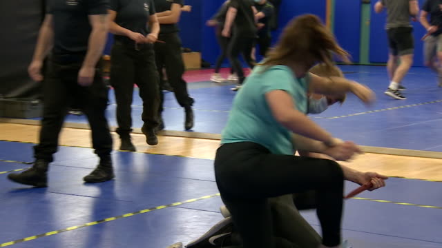 police officers trainees learning how to disarm someone carrying a knife in training centre in kent - touching stock videos & royalty-free footage