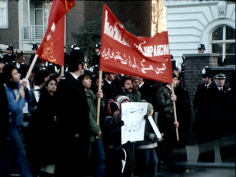 police officers walk alongside demonstrators at prokhomeini rally london 3 february 1979 - revolution stock videos & royalty-free footage