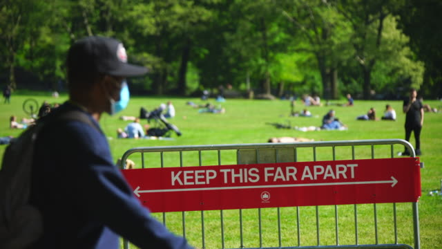 police officers will limit access to the central park sheep meadow to prevent overcrowding. - state of emergency stock videos & royalty-free footage