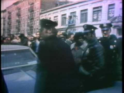 police officers with riot batons move in single file in harlem as spectators watch. - 1972 stock videos & royalty-free footage