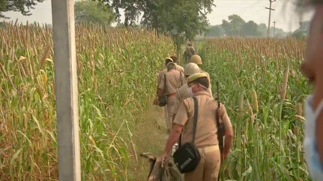 police officials going in the field with bulletproof vest where the incident happened the team is going inside the field for the investigation and to... - uttar pradesh stock videos & royalty-free footage