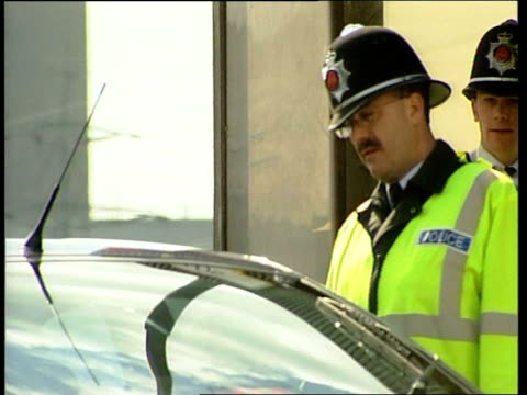 police on duty at entrance barrier as bv car arrives cms policeman up to car bv policeman away to police van london gir int jack dromey interview sot... - sabotage stock videos & royalty-free footage