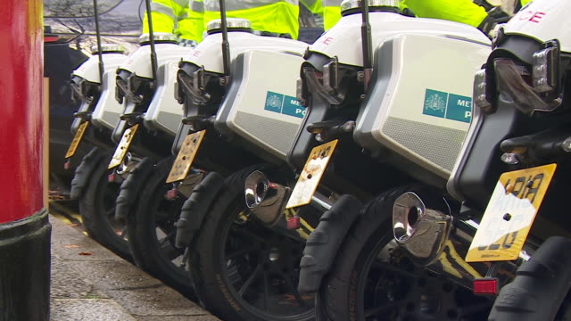 police on motorcycles outside the houses of parliament as the queen gives her speech to reopen parliament after the general election - mirror stock videos & royalty-free footage