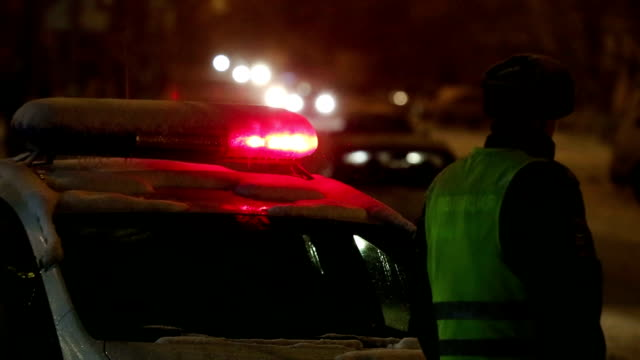 police on night road in the snow - russia stock videos & royalty-free footage