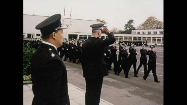 montage police on parade in police college in scotland / united kingdom - saluting stock videos & royalty-free footage
