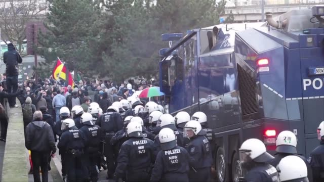 police on saturday fired tear gas and used a water cannon to clear a rally in cologne of the farright xenophobic pegida movement after protesters... - confrontation stock videos and b-roll footage