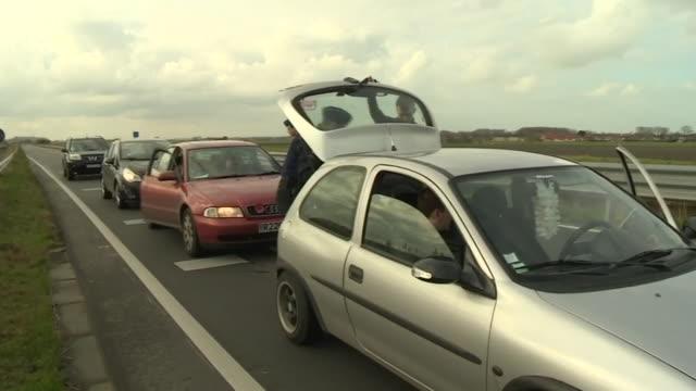 police on the belgium-france border performing spot checks on drivers to check for symptoms of coronavirus - stato di emergenza video stock e b–roll