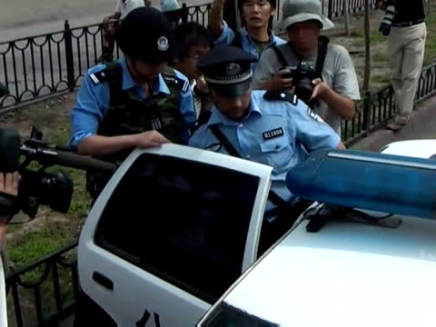 police on tuesday fired clouds of acrid tear gas to disperse thousands of han chinese protesters, as chaos gripped this flashpoint city riven by... - 2009 stock videos & royalty-free footage