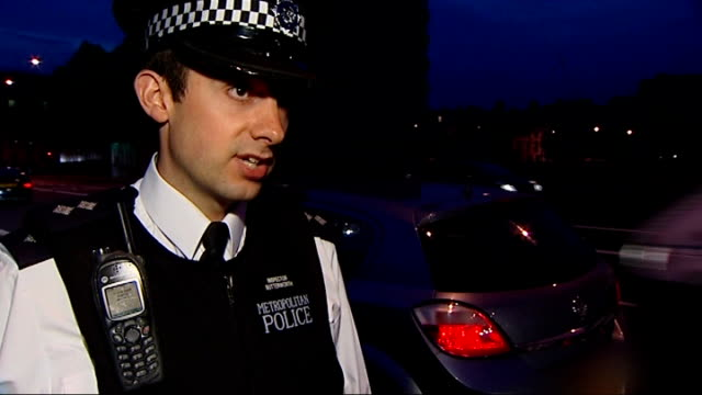 police operation on london bridges and at stations to tackle cross-london crime; england: london vauxhall: ext at night police officer stopping car... - セキュリティスキャナ点の映像素材/bロール