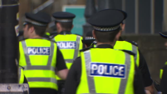 """police outside the park inn hotel in glasgow the day after a knife attack - """"bbc news"""" stock videos & royalty-free footage"""