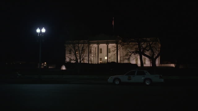 WS Police park parked in front of White House at night / Washington, D.C., United States