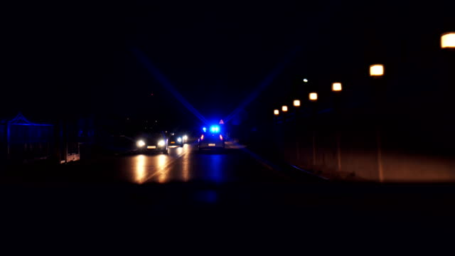 police patrol car drive with emergency lights flashing - headlight stock videos & royalty-free footage