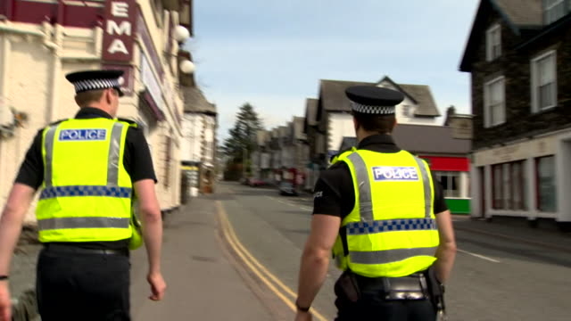 police patrol streets of bowness in the lake district during coronavirus lockdown, making sure that bed and breakfasts are shut and there are no... - breakfast stock videos & royalty-free footage