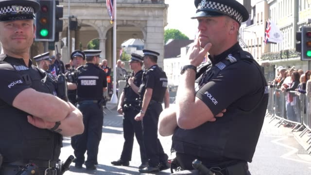 police patrol the streets close to windsor castle ahead of the royal wedding of prince harry to ms meghan markle on saturday in windsor on may 17... - meghan harry stock videos and b-roll footage
