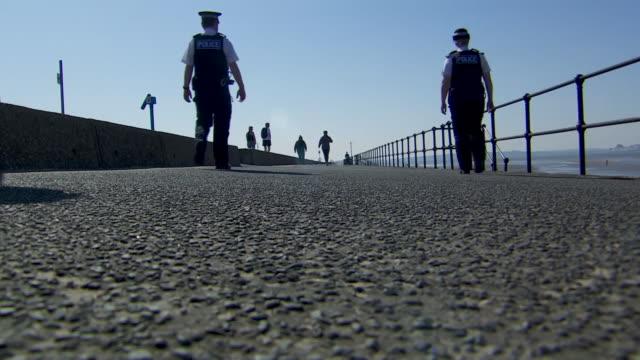 police patrolling crosby beach to make sure people observe social distancing during coronavirus lockdown - looking stock videos & royalty-free footage