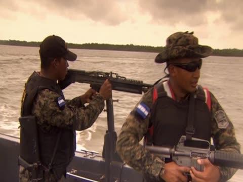 stockvideo's en b-roll-footage met police patrolling mosquito coast for drug smugglers - ongewerveld dier