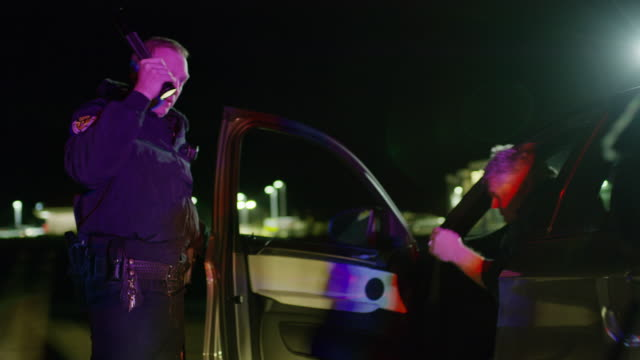 police performing sobriety test on drunk driver at night / eagle mountain, utah, united states - alkoholtest stock-videos und b-roll-filmmaterial