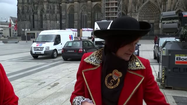 police preparations ahead of cologne carnival / vigilante patrols in gerstungen; germany: cologne: ext women in town square dressed in traditional... - stencil stock videos & royalty-free footage