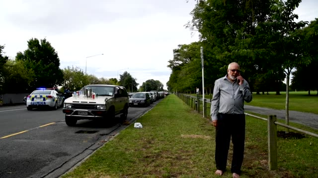 police presence at the masjd al noor mosque march 15 2019 in christchurch new zealand 49 people have been confirmed dead and more than 20 are injured... - christchurch stock-videos und b-roll-filmmaterial