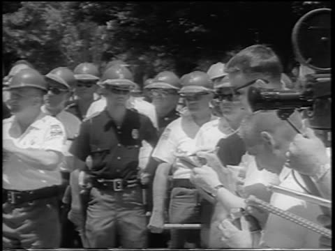 B/W 1963 police press outside building during desgregation of U of Alabama / newsreel