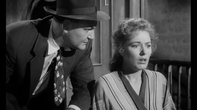 stockvideo's en b-roll-footage met 1955 police question handicapped woman (eleanor parker) about an incident - achterdocht