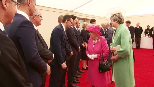 Police raid offices of Australian public broadcaster ABC ENGLAND Hampshire Portsmouth INT Queen Elizabeth II and Theresa May MP meeting world leaders...