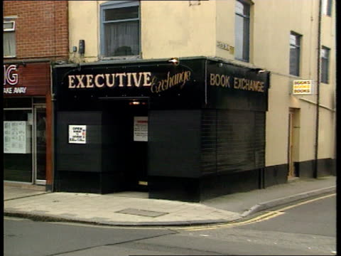 police raid shops and homes in pornography ring investigation; b)nao england: hampshire: southampton: ext shop raided by police during breaking of... - b rolle stock-videos und b-roll-filmmaterial