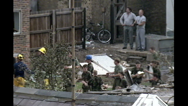 police raids foil plot to kill british muslim soldier tx deal ext fire fighters and soldiers removing rubble from building in aftermath of ira... - barracks stock videos and b-roll footage