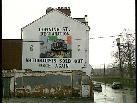 police raids on irish border ext lms mural on side of house downing st declaration nationalists sold out once again zoom la ms irish flag flying from... - northern ireland stock videos & royalty-free footage