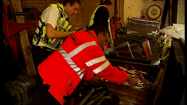 police raids target scrap metal dealers t29071113 / int network rail expert inspecting box containing copper cables suspected to have been stolen... - cable box stock videos and b-roll footage