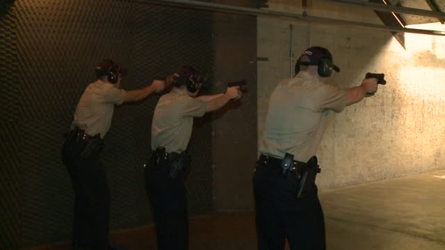 police recruits firing guns at range on september 07, 2013 in chicago, illinois - military recruit stock-videos und b-roll-filmmaterial