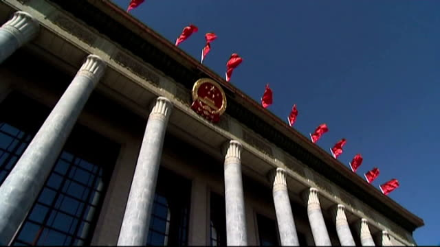 vídeos y material grabado en eventos de stock de police recruits march along red china flags flying from unidentified government buildings police officers checking man's passport in street almost... - military recruit