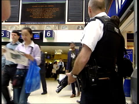 reforms / blair keynote speech file / july 2005 armed police on duty at main line train stations trafalgar sqaure ext children having olympic rings... - olympic rings stock videos & royalty-free footage