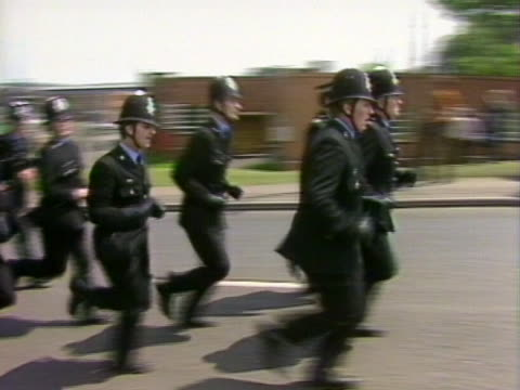 Police reinforcements come to the aid of their colleagues at a picket line outside the Orgreave coking plant in Yorkshire
