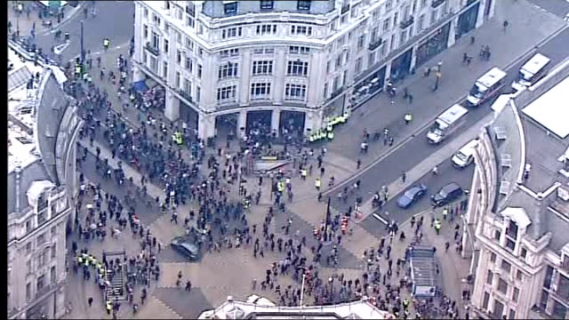 police release cctv footage of recent anti-cuts march; t26031133 england: london: oxford circus: ext air view / aerial anti government cuts... - protestor stock videos & royalty-free footage