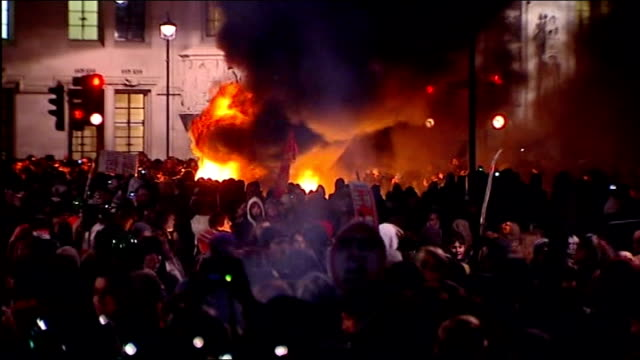 police release new footage of student attack on royal car 9122010 fire burning on street in front of treasury building with large crowd of student... - finanzministerium stock-videos und b-roll-filmmaterial