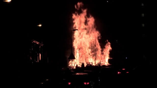 police retreated from a confrontation at a belfast bonfire site over concerns innocent bystanders could be hurt, a senior commander has said.... - ガソリン点の映像素材/bロール
