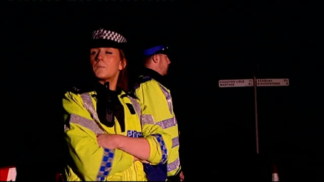 police roadblock near scene where body of sian o'callaghan was found; two police officers standing next to 'road closed' sign / police car along /... - road sign stock videos & royalty-free footage