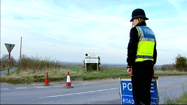 Police roadblock near scene where body of Sian O'Callaghan was found ENGLAND Oxfordshire Near Wantage Uffington Hill EXT Police jeep in road / road...