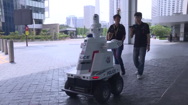 a police robot patrols the suntec city convention and exhibition centre during the 33rd association of southeast asian nations summit in singapore - association of southeast asian nations stock videos & royalty-free footage