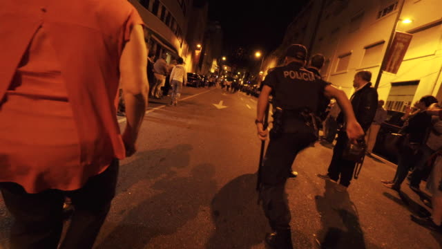 police running at traditional festival - Porto, Portugal