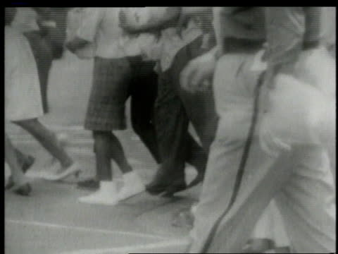 police running toward civil rights rioting / alabama united states - anno 1963 video stock e b–roll