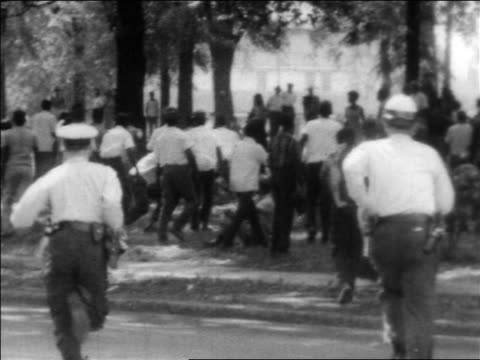 view police running towards fleeing black protesters at civil rights protest / alabama - human rights stock videos and b-roll footage