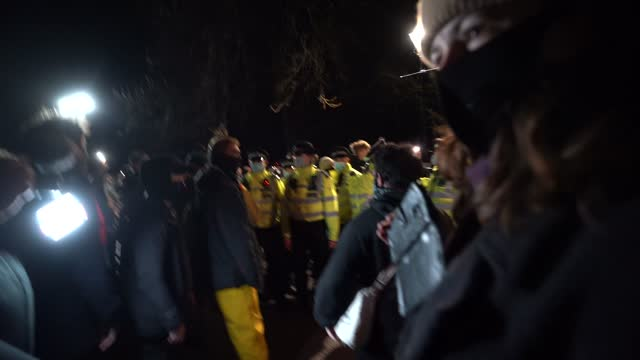 police scuffle with people gathering at the band-stand where a planned vigil in honour of murder victim sarah everard, which was officially cancelled... - crime stock videos & royalty-free footage