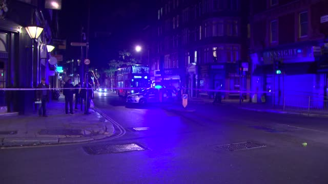 Police search area around Gray's Inn Road ENGLAND London Police on cordoned off junction / police dog searching area / Police van along with flashing...