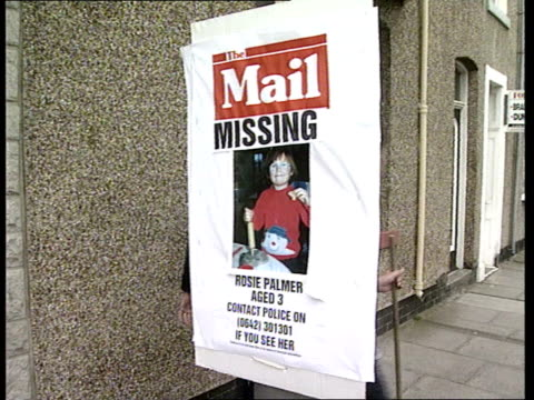 police search for missing toddler rosie palmer england hartlepool ext two police towards as past poster for missing child on lamp post det chief insp... - itv weekend evening news stock-videos und b-roll-filmmaterial
